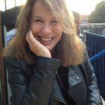 The poet Sue Hubbard, smiling.