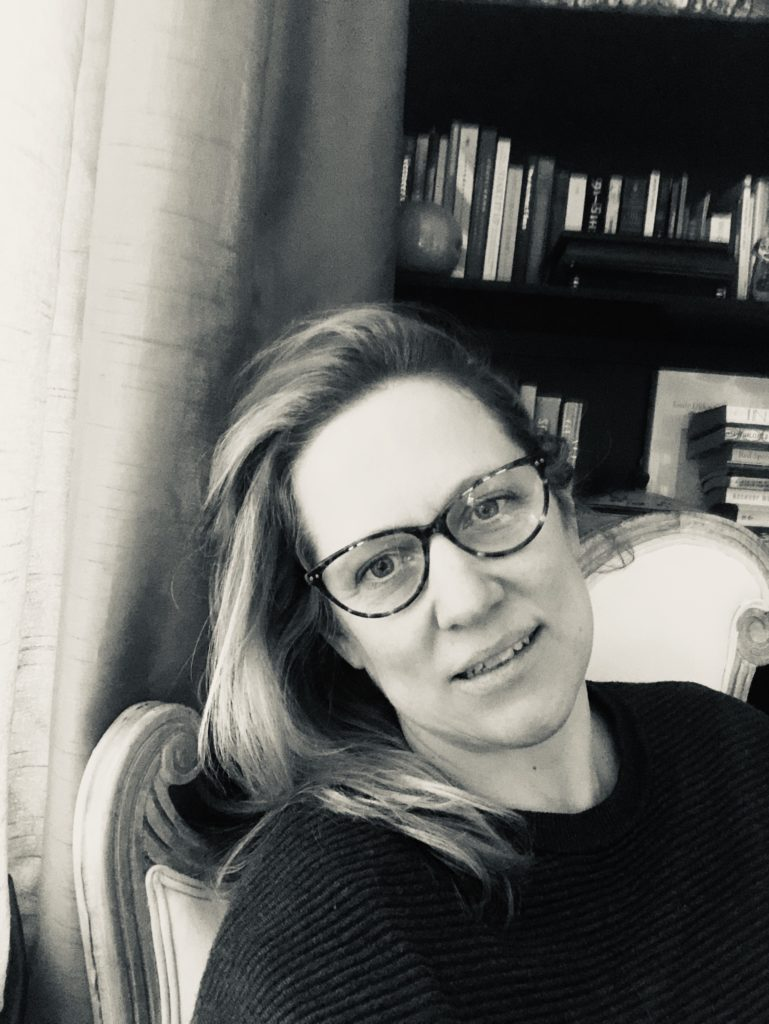 A black and white photograph of the writer Natasha Randall.