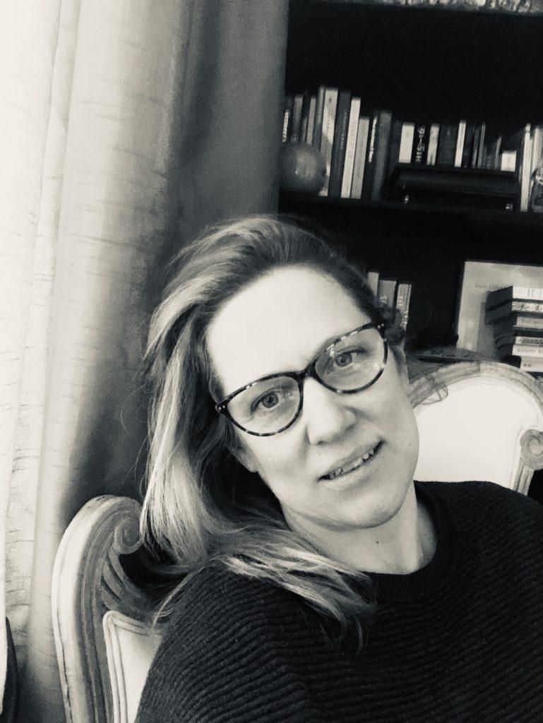 A black and white photograph of the writer Natasha Randall.