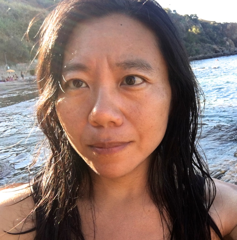 Photograph of Xiaolu Guo out at sea.