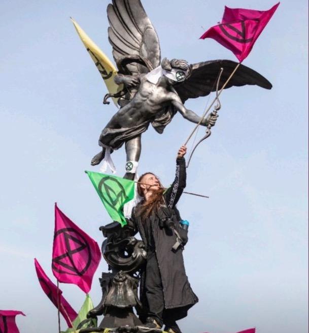 Iggy Fox on the Eros Statue in London.